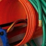 Which of these is the best way to hang electrical cords and hoses?